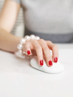 Woman with Red Fingernails Using Mouse --- Image by © Turbo/Corbis